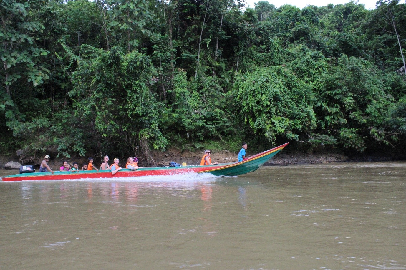 Travelling by boat to the village (kampung) of Sikalabaan, about two hours up-river from Kampung Salong, where the road ends.